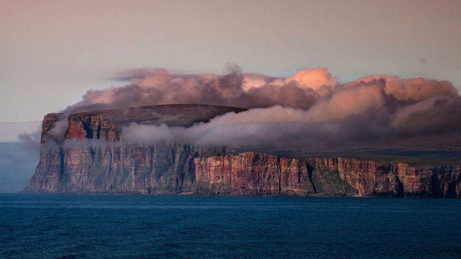 Orkney Cliffs. Orkney Islands, United Kingdom. Check This Out Cliff Cloud Clouds On Cliff Eye4photography  EyeEm Best Shots EyeEm Gallery First Eyeem Photo Landscape_Collection Landscape Photography Malephotographerofthemonth Orkney Orkneyislands Red Cliffs Scotland Seascape Seaside Cliff Sunset Travel Destinations Travel Photography Water Fresh On Market 2016