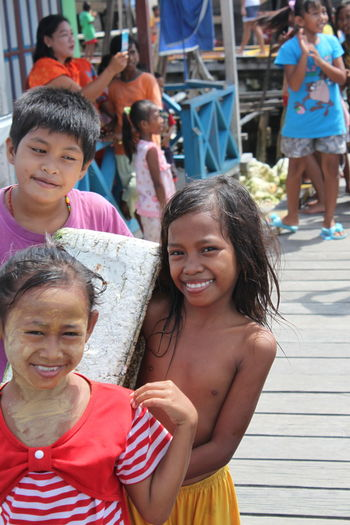 Boys Cheerful Childhood Day Elementary Age Enjoyment Excitement Fun Girls Happiness Leisure Activity Lifestyles Looking At Camera Outdoors Portrait Real People Sea Gypsies Smiling Togetherness Togian Islands... Vacations