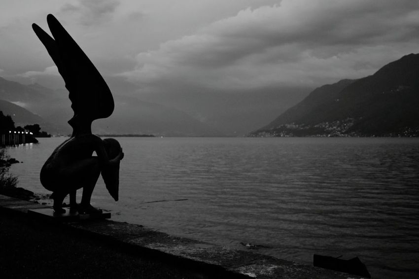 Statue at Lago Maggiore, Bressagio, Switzerland Sculpture Water Statue Silhouette Outdoors No People Beauty In Nature Lago Maggiore Lago Maggiore, Italy Lago Maggiore Morning Scene Blackandwhite Lake View Lakescape Lakeshore Your Ticket To Europe Travel Destinations Waterfront_challenge Lost In The Landscape Connected By Travel Black And White Friday
