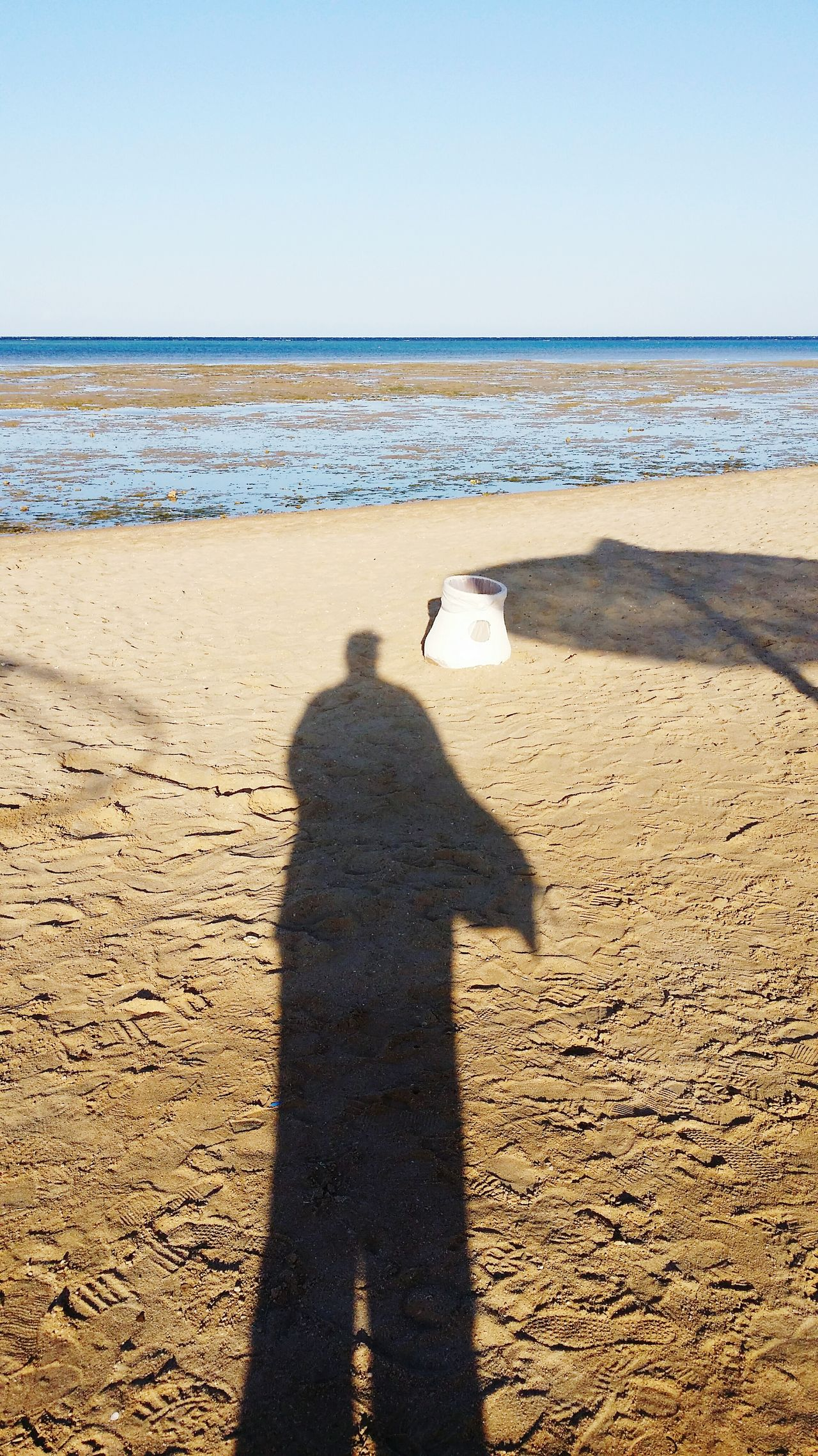 Shadow...thats me 😉 Shadow Sunlight Focus On Shadow Real People Beach One Person Clear Sky Sea Outdoors Leisure Activity Day Adults Only Sand Horizon Over Water Adult People Sky Technology Only Men Human Hand Ladyphotographerofthemonth No Filter, No Edit, Just Photography Egypt Red Sea Makadi Bay Egypt