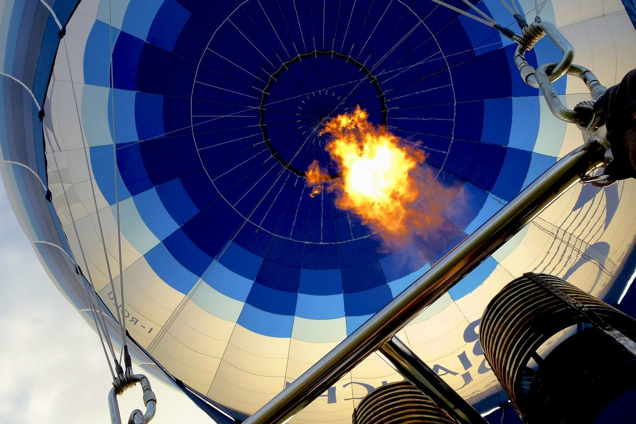 Air Ballons Blue Design Fire In The Sky Hot-air Balloon Low Angle View Mid-air Multi Colored No People Outdoors Sky Photography In Motion