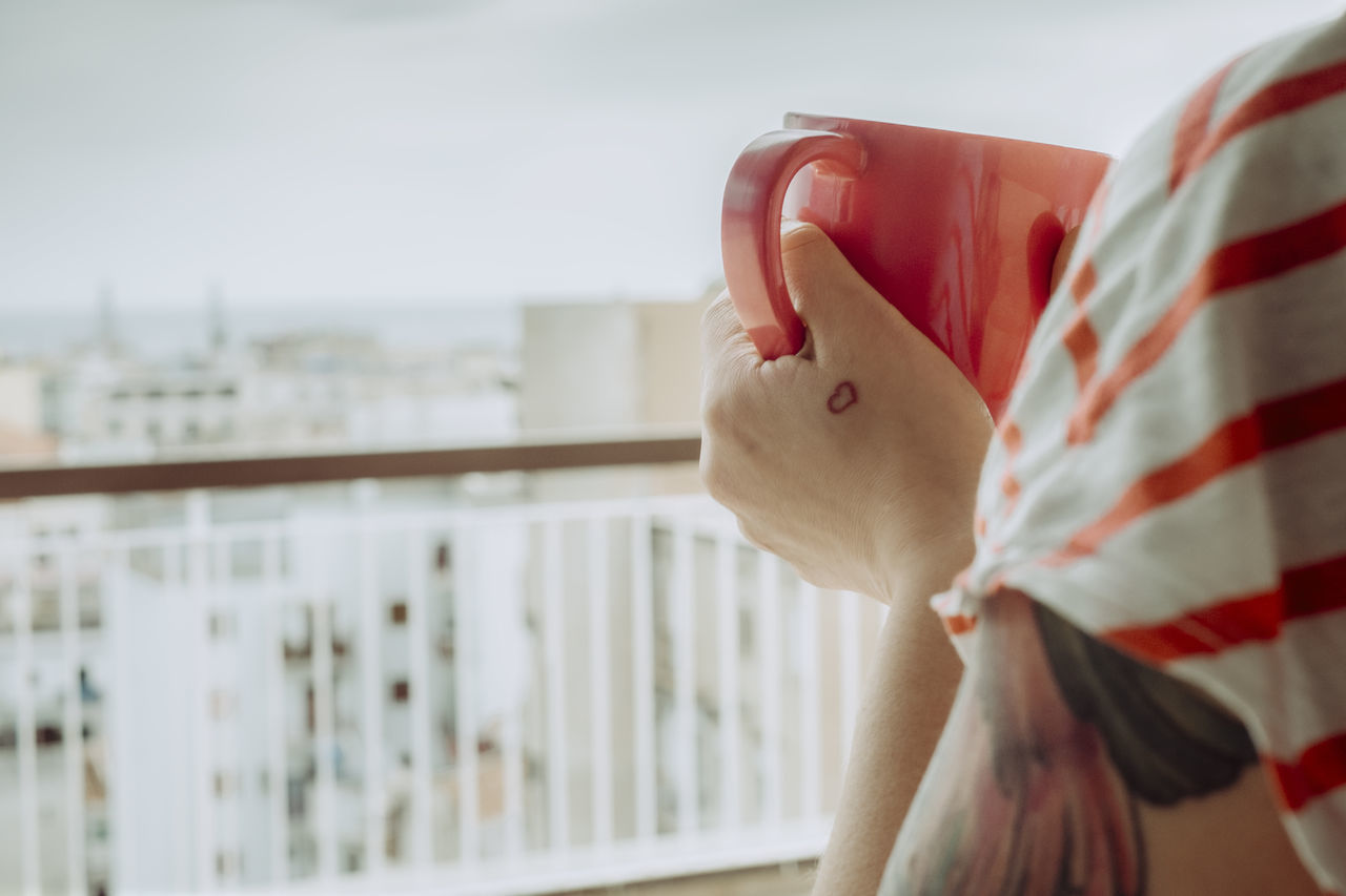 Coffee with a view Balcony Balcony View City Cityscape Coffee Coffee Cup Focus On Foreground Holding Morning Morning Rituals One Person People Real People Tattoo Travel Destinations Travel Photography Vacation Vacation Time View Woman