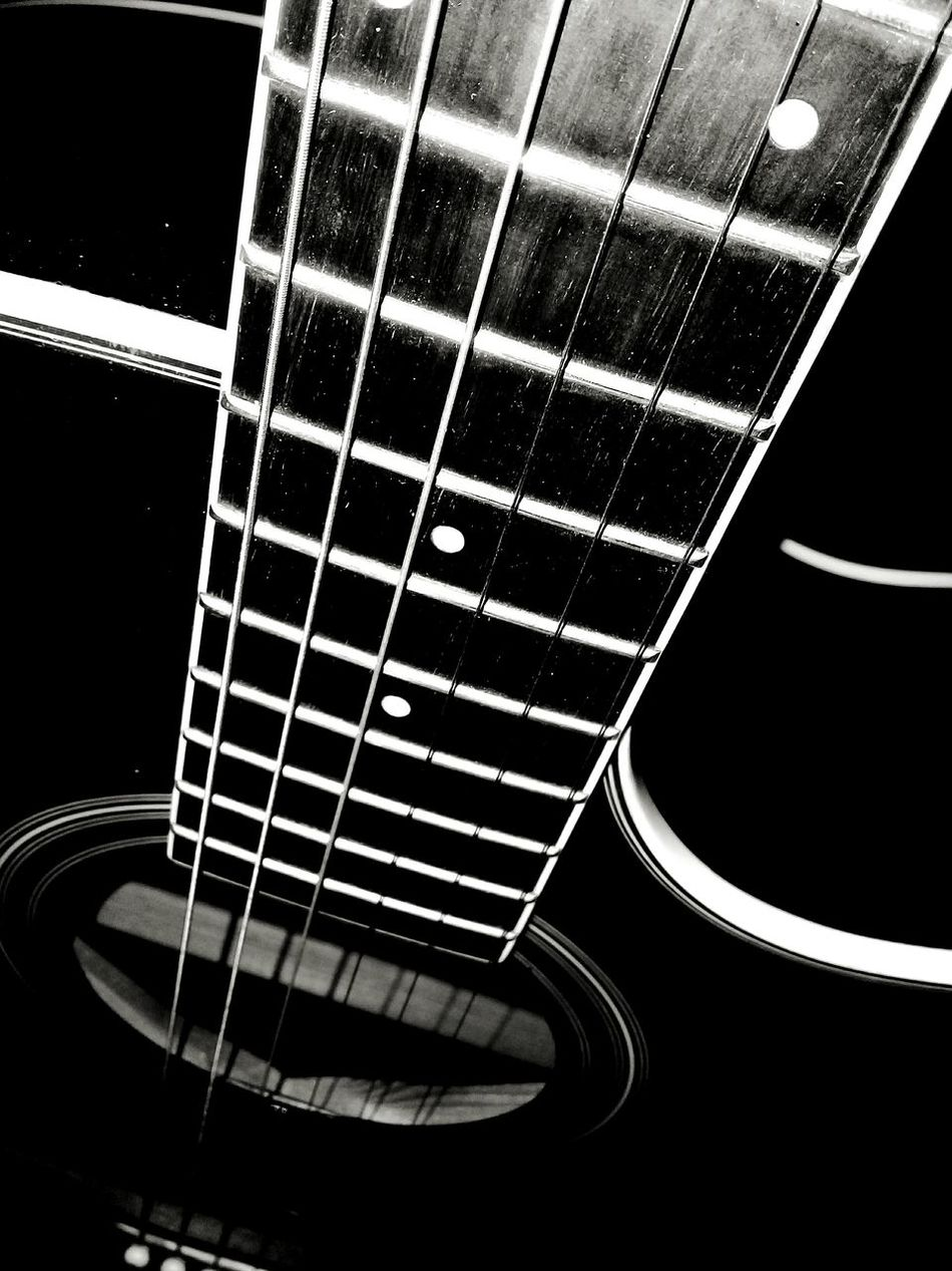 Just an ordinary song. Musical Instrument Guitar Musical Instrument String Black Background Indoors  Day Singing In The Rain Enjoying The Rainy Weather Blackandwhite Photography EyeEm Gallery Eyeemphotpgraphy Eyeem Philippines Eyeemmarket Eye4photography  TheWeekOnEyeEM Eyeemph EyeemPhilippines