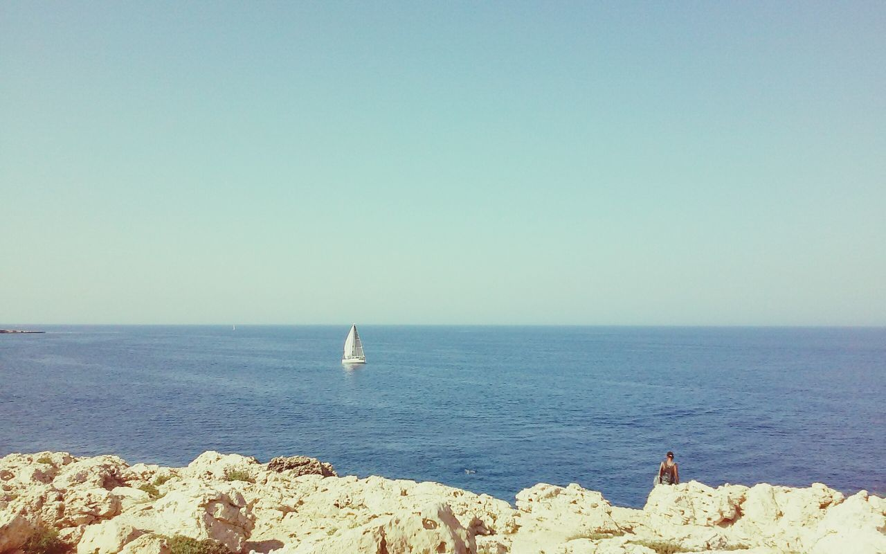 Descovering Places Concept Horizon Over Water Blue Sea Rocks People Traveling Travel Photography Boat Sails Sailing Blue Sky Minimalism Minimal Clear Waters