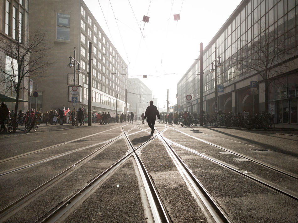 Adult Adults Only Alexanderplatz Architecture Building Exterior Built Structure City City Life Day Full Length Light And Shadow Men Misty Morning One Man Only One Person Only Men Outdoors People Real People Rear View Sky The City Light Transportation
