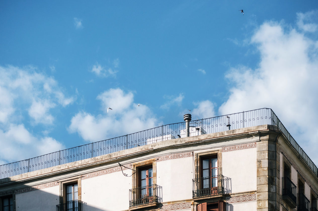 The sky above the building Angles And Lines Architectural Feature Architecture Barcelona, Spain Birds In Flight Building Exterior Built Structure Catalonia Cloud - Sky Geometric Shape Geometric Shapes Low Angle View Outdoors Sky Spaces Windows