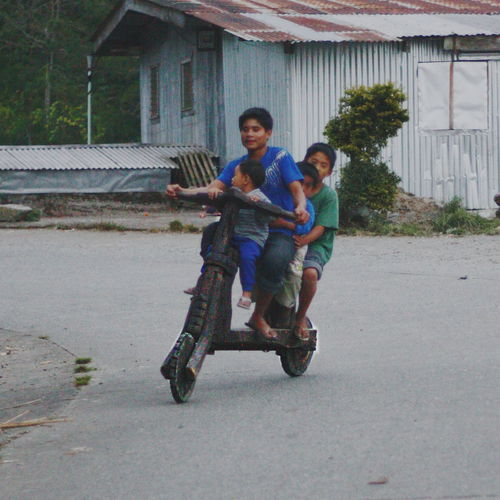 Bonding Boys Cheerful Childhood Fun Happiness Leisure Activity Local Mode Of Transport Local Ride Outdoors Real People Ride Smiling The Great Outdoors - 2017 EyeEm Awards The Street Photographer - 2017 EyeEm Awards Togetherness Unique Ride Wooden Scooter