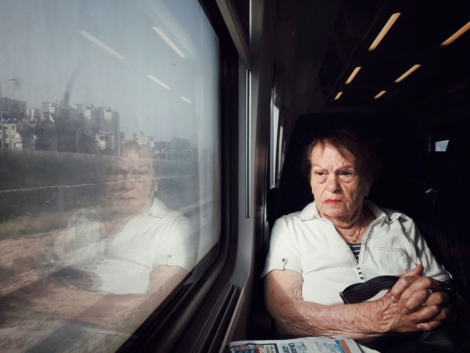 Window Real People One Person Senior Adult Looking Through Window Front View Indoors  Sitting Lifestyles Day Portrait IPhone7Plus Shotoniphone7plus מייאייפון7 Mydtrainmoments Mytrainmoments