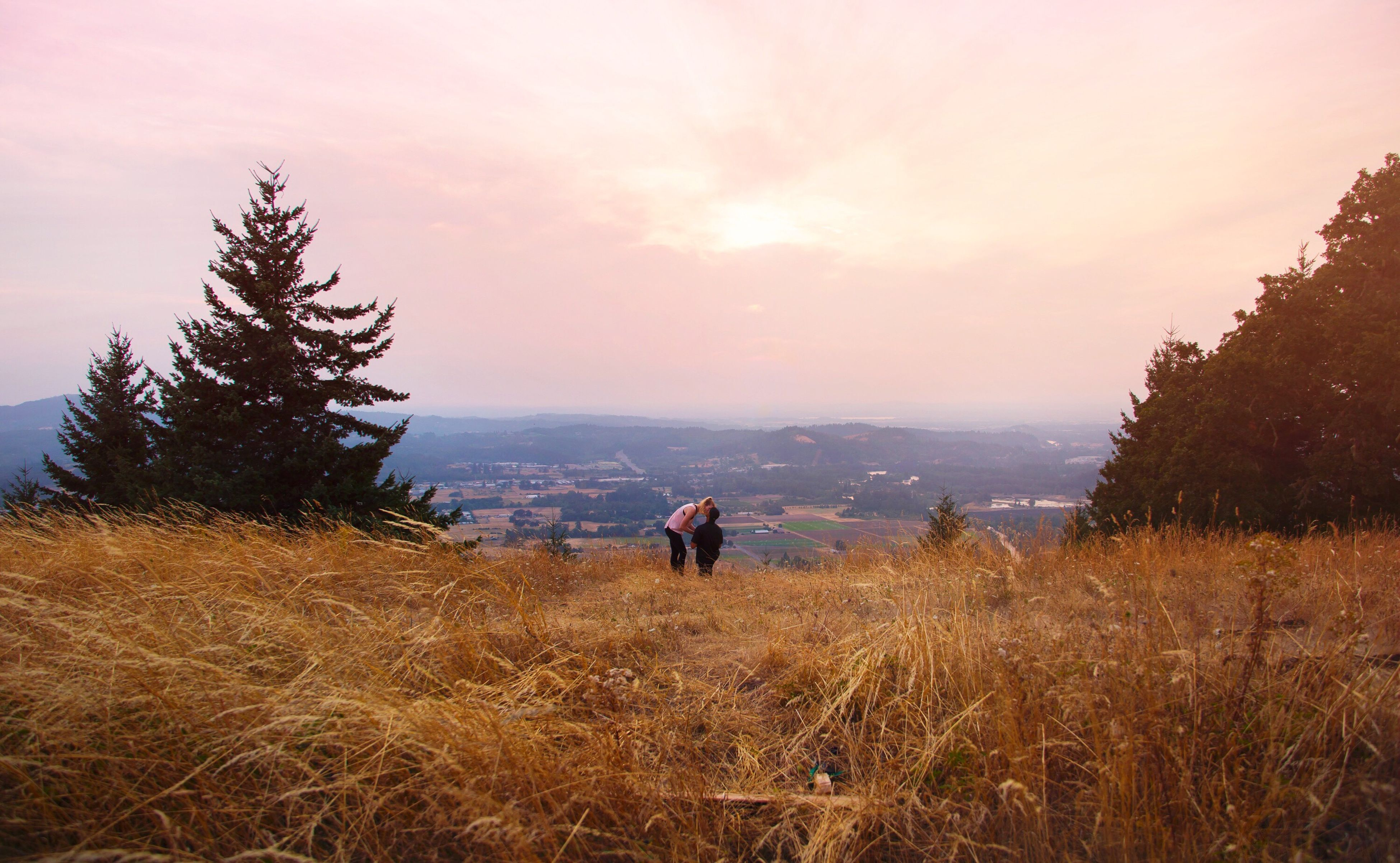 nature, real people, sunset, beauty in nature, one person, field, lifestyles, landscape, leisure activity, grass, sky, walking, scenics, tranquility, outdoors, men, mountain, growth, adventure, standing, tree, day, people