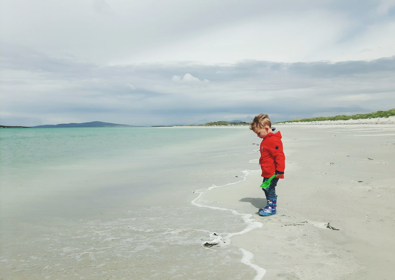 One Boy Only Children Only Child Playing At The Beach Children Of The World EyeEmNewHere Live For The Story Toddlersofeyem The Great Outdoors - 2017 EyeEm Awards The Portraitist - 2017 EyeEm Awards Scottish Beaches Uist Scottish Beach Outerhebrides Hebrides Nortuist Childphotography Child At Beach Clachan Clachansands Toddler Boy Beauty In Nature Cloud - Sky Scotland Toddler  BYOPaper! Place Of Heart