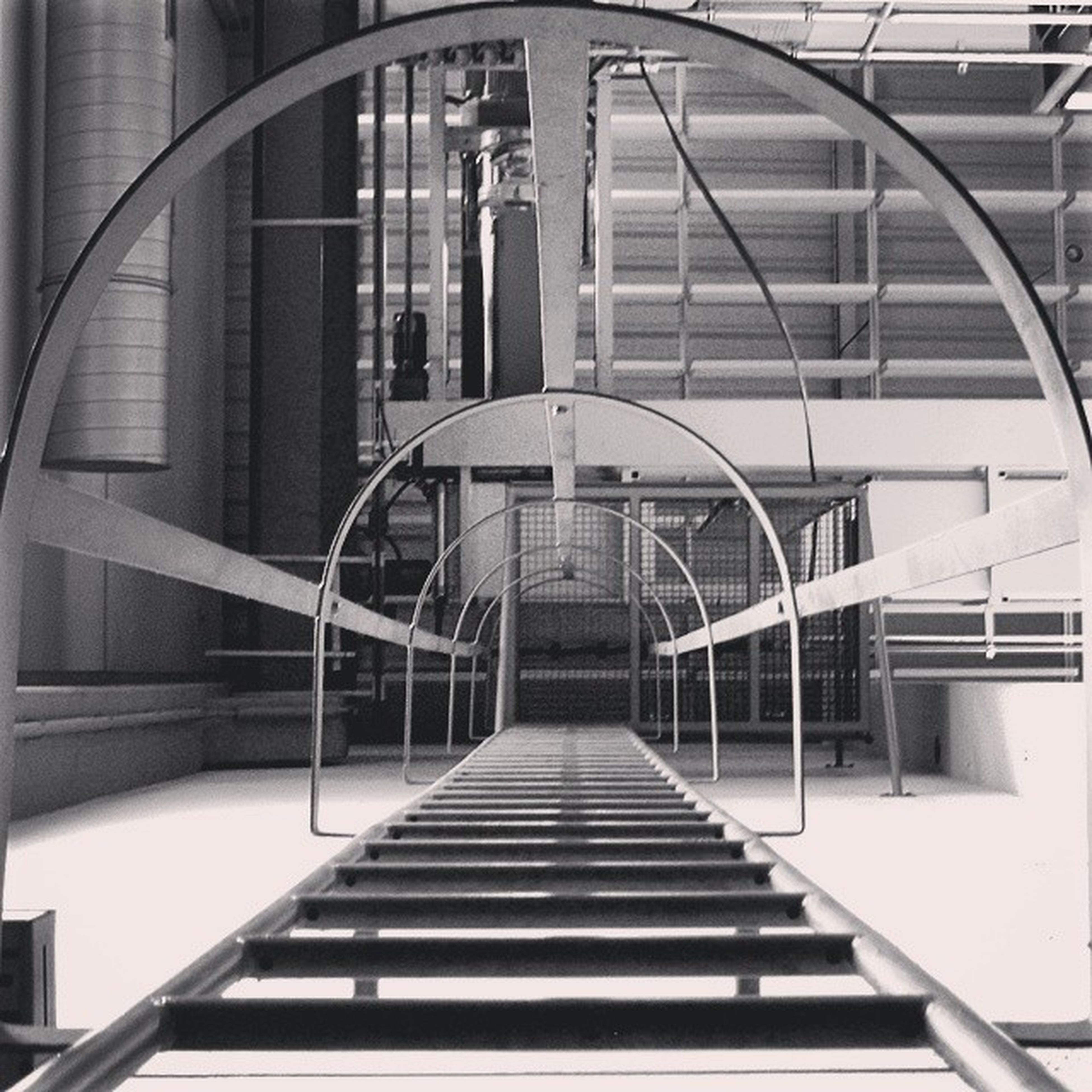 architecture, built structure, staircase, steps, railing, steps and staircases, building exterior, building, the way forward, low angle view, diminishing perspective, modern, stairs, day, city, no people, vanishing point, spiral staircase, outdoors, window