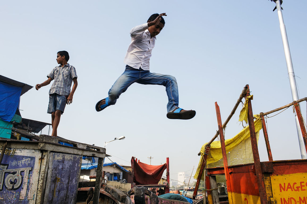 A jumping boy in the south of Colanba area in Mumbai. January 2015. ASIA India Jumping Mid-air Moment Mumbai Street Photography Streetphotography