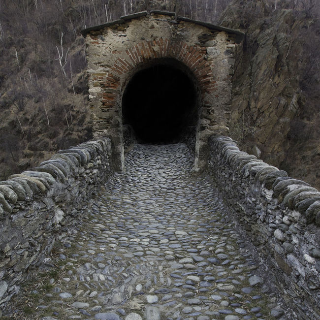 Seduzione del buio Ancient Arch Archway Attraction Bad Condition Ceiling Column Dark Hole Deterioration Devil's Bridge Historical Building History Hole Indoors  Interior Malignant Obsolete Old Pattern Ruined Seduction Stone Stone Wall Tunnel