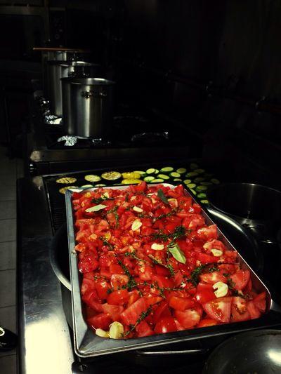 Preparing our kritharoto with fresh oven tomato...