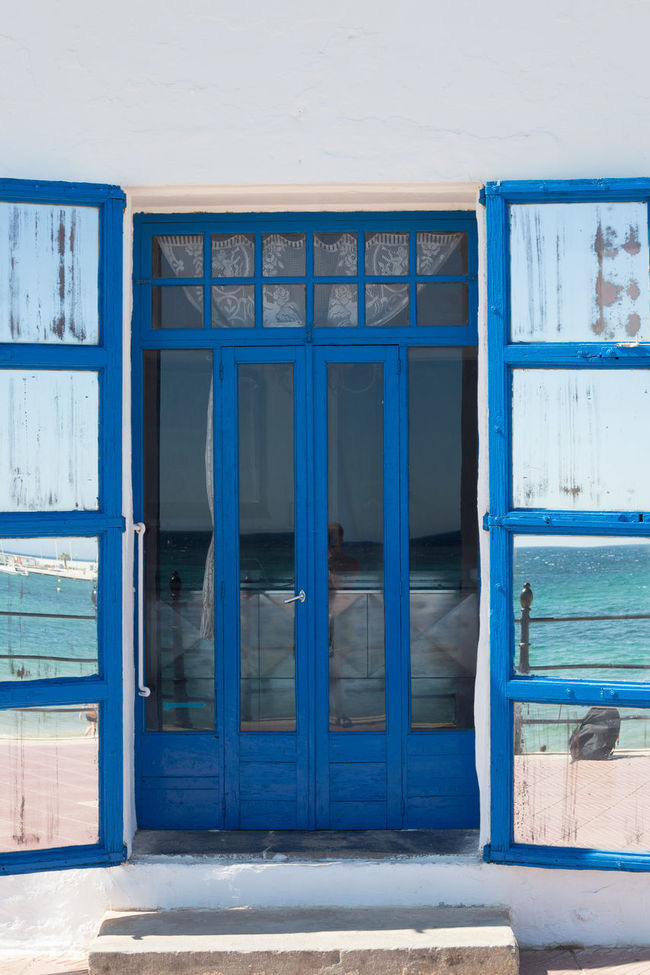 Mirrored door. Absence Architecture Blue Building Built Structure Closed Day Doors Empty Exterior Façade Mirror No People Open Outdoors Wood - Material