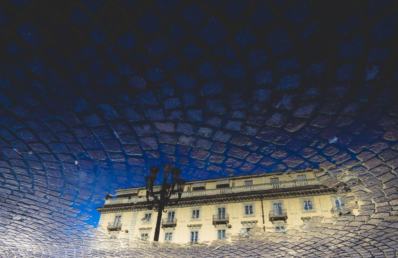 Reflection in Turin Architecture Building Exterior Built Structure City Day Floor Low Angle View No People Outdoors Pattern Puddle Reflection Reflections In The Water Sky Torino