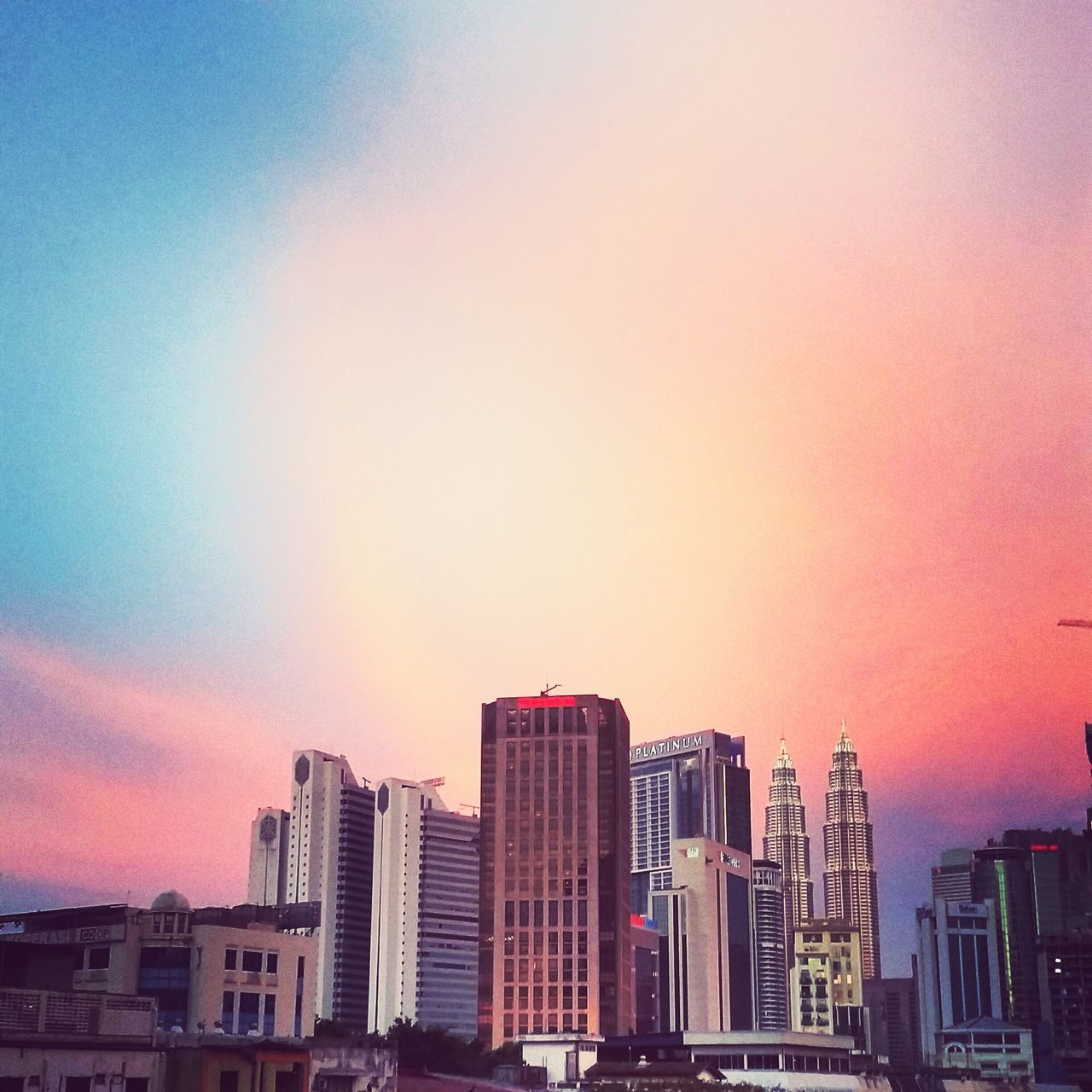 architecture, building exterior, skyscraper, built structure, modern, city, sunset, sky, cityscape, no people, outdoors, urban skyline, travel destinations, day