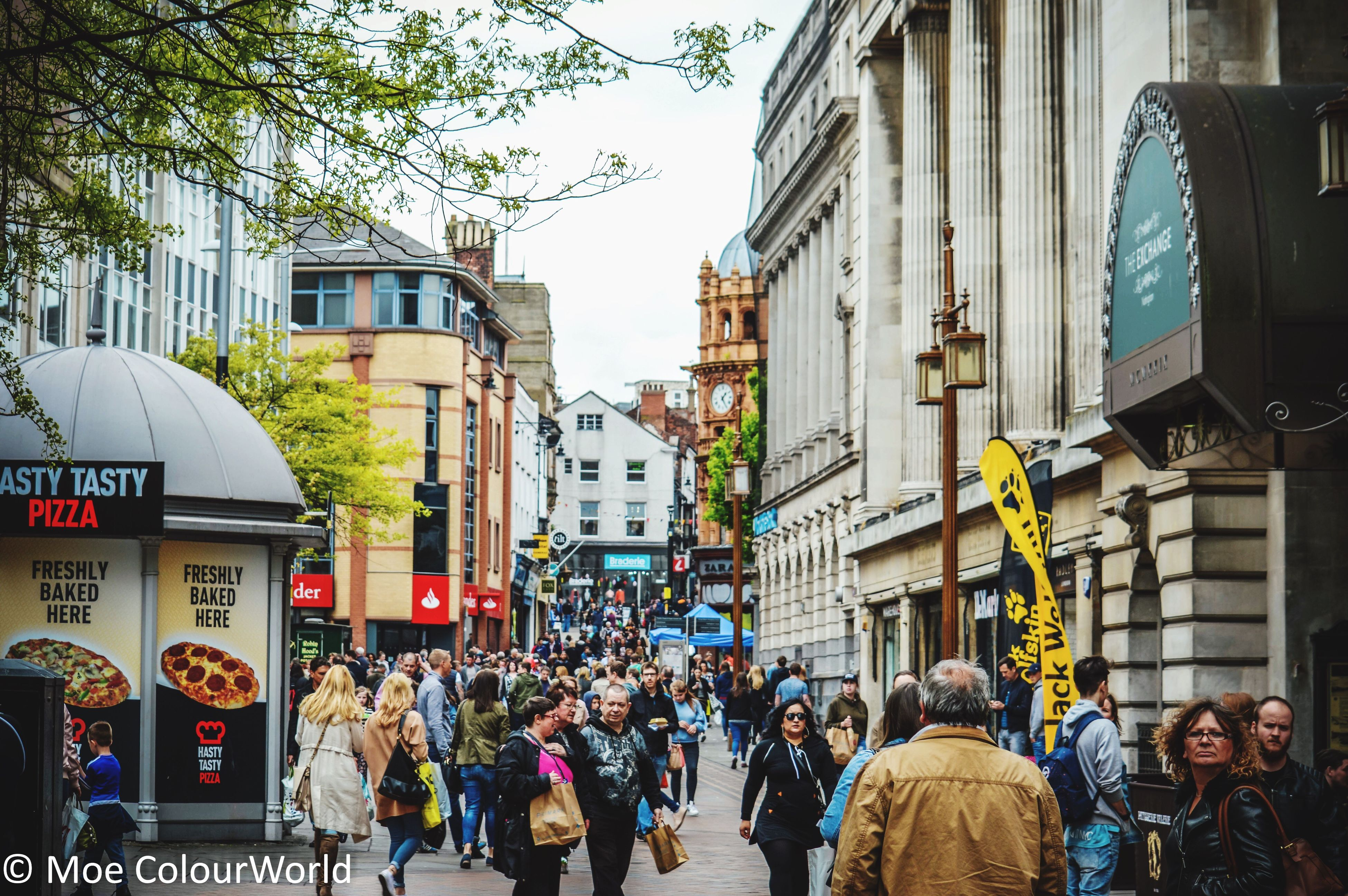building exterior, architecture, built structure, large group of people, city, real people, city life, day, street, outdoors, men, women, crowd, people