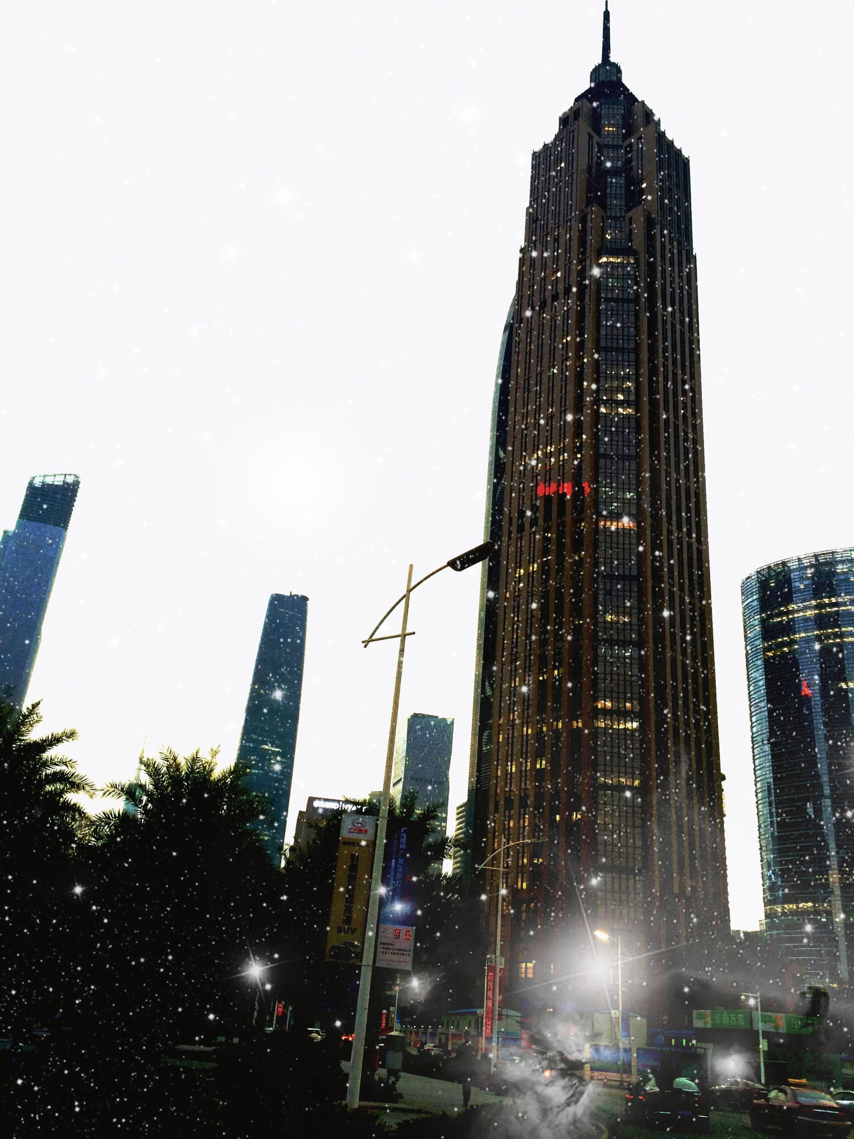 building exterior, architecture, built structure, city, skyscraper, tall - high, tower, office building, car, clear sky, modern, city life, land vehicle, capital cities, low angle view, transportation, street, building, city street, mode of transport