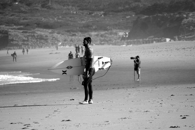 Surfers Black & White Black And White Blackandwhite Surf's Up Şūr Blackandwhite Photography Bnw Eye4photography  EyeEm Best Shots EyeEm Bnw EyeEmBestPics Seaside People Photography EyeEm People Watching Taking Photos Of People Taking Photos Beachphotography Sport Surf EyeEm Gallery Taking Photos at Guincho Billabong Pro Cascais 2016 Portugal