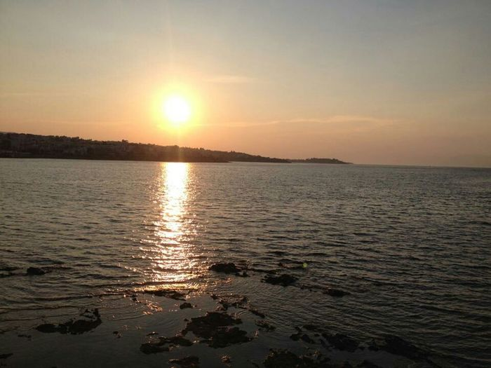 Sun setting in Xalkida, Greece. Sunset Water Reflections GREECE ♥♥ Xalkida