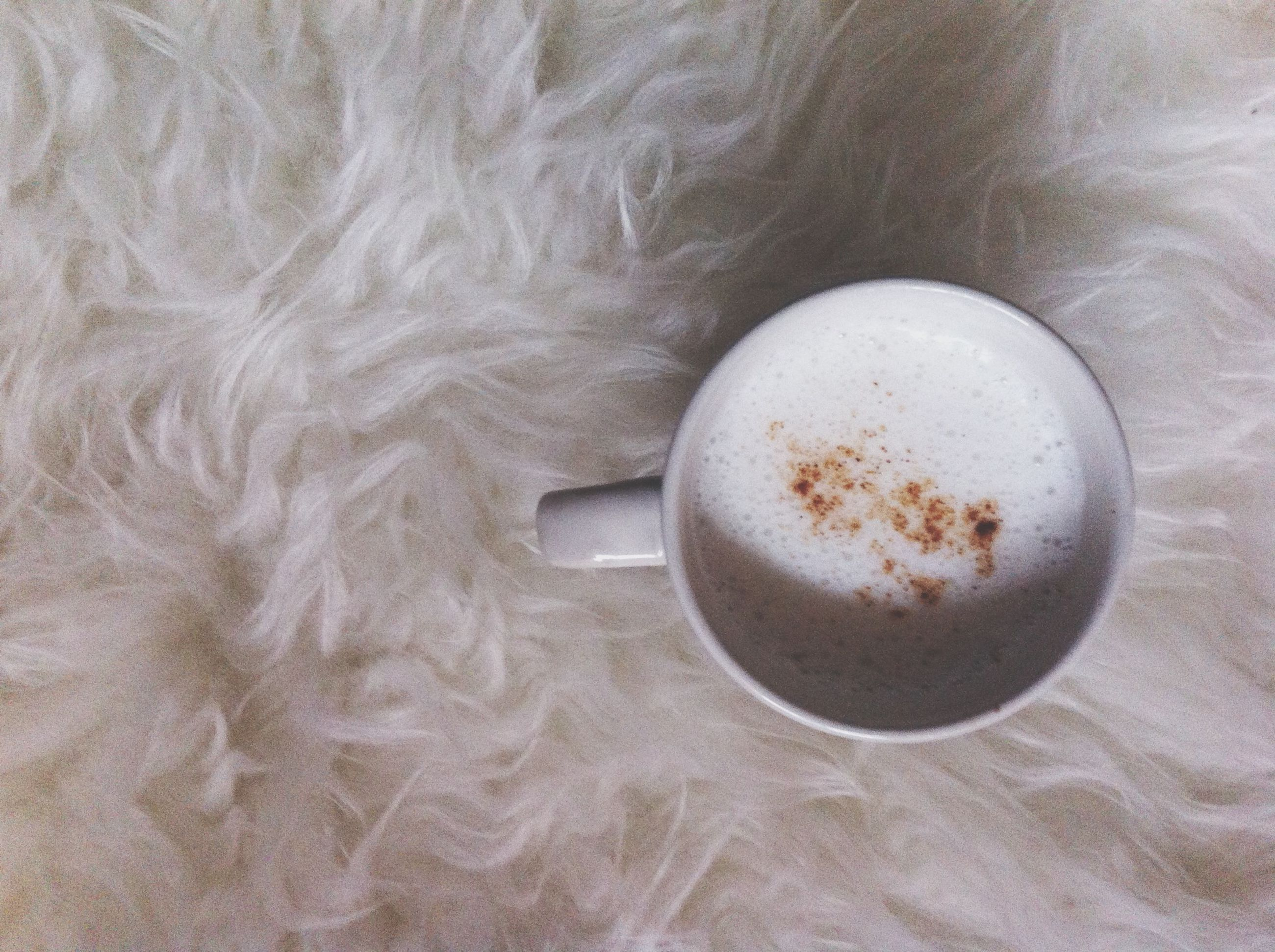 indoors, food and drink, coffee cup, high angle view, drink, table, refreshment, still life, coffee - drink, close-up, cup, coffee, directly above, white color, freshness, saucer, spoon, no people, frothy drink, day