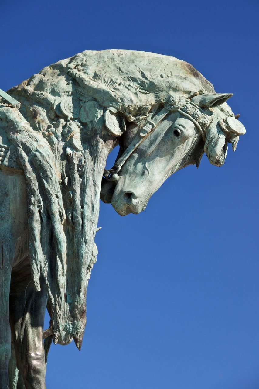Low Angle View Of Horse Statue Against Clear Sky