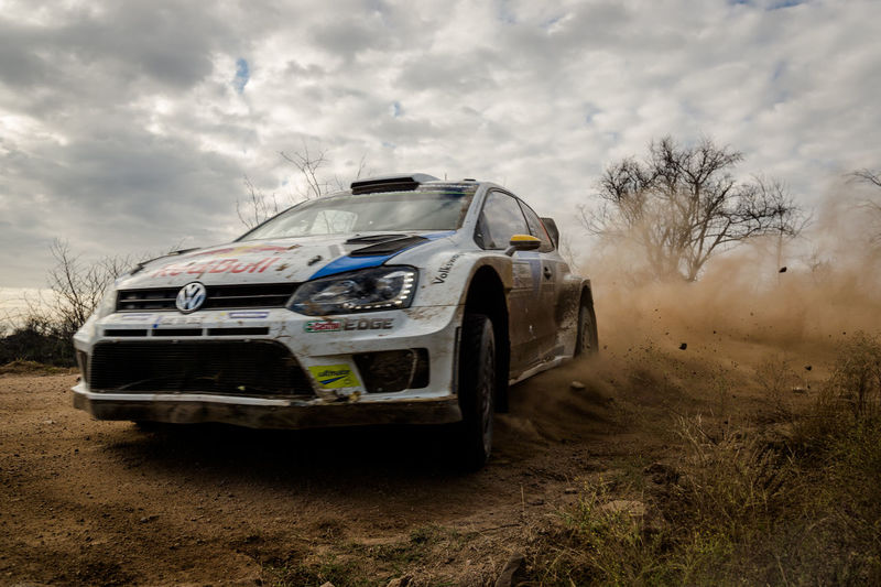 Closeup of Car World Rally Car 2014 Moving on a dirt Road with a Dramatic Sky