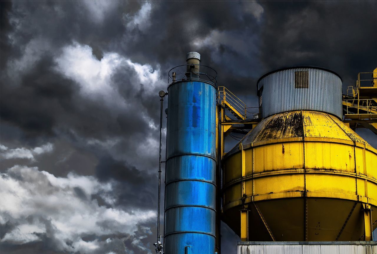 Factory Storage Tank Industry Fuel And Power Generation Low Angle View Oil Refinery Sky Oil Industry Refinery Cloud - Sky Smoke Stack Yellow No People Outdoors Day Petrochemical Plant Sony Sonyalpha The Street Photographer - 2017 EyeEm Awards The Great Outdoors - 2017 EyeEm Awards The Architect - 2017 EyeEm Awards