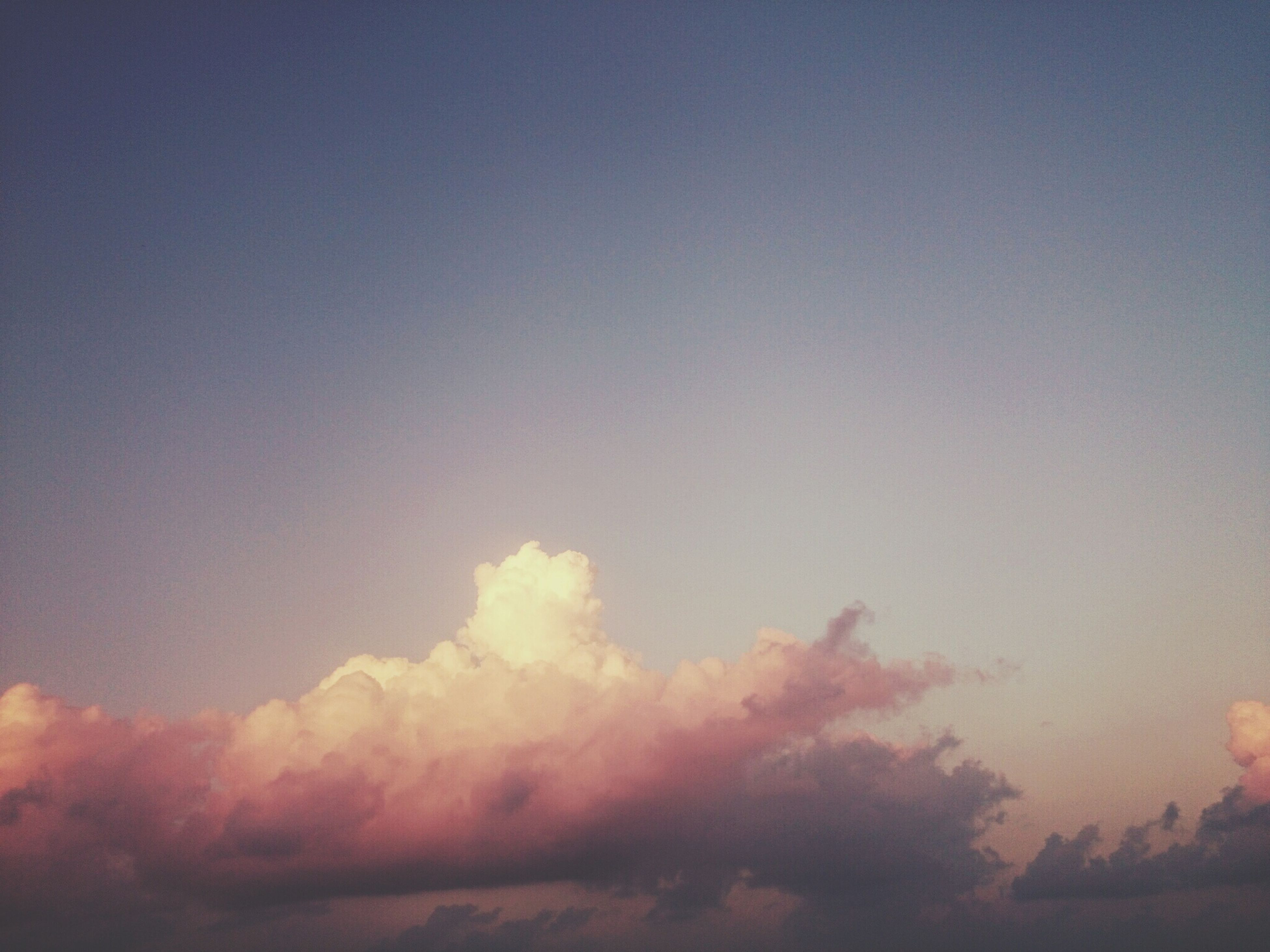 sky, beauty in nature, scenics, low angle view, tranquility, sunset, tranquil scene, nature, sky only, cloud - sky, idyllic, copy space, cloudscape, silhouette, majestic, outdoors, no people, blue, cloud, backgrounds