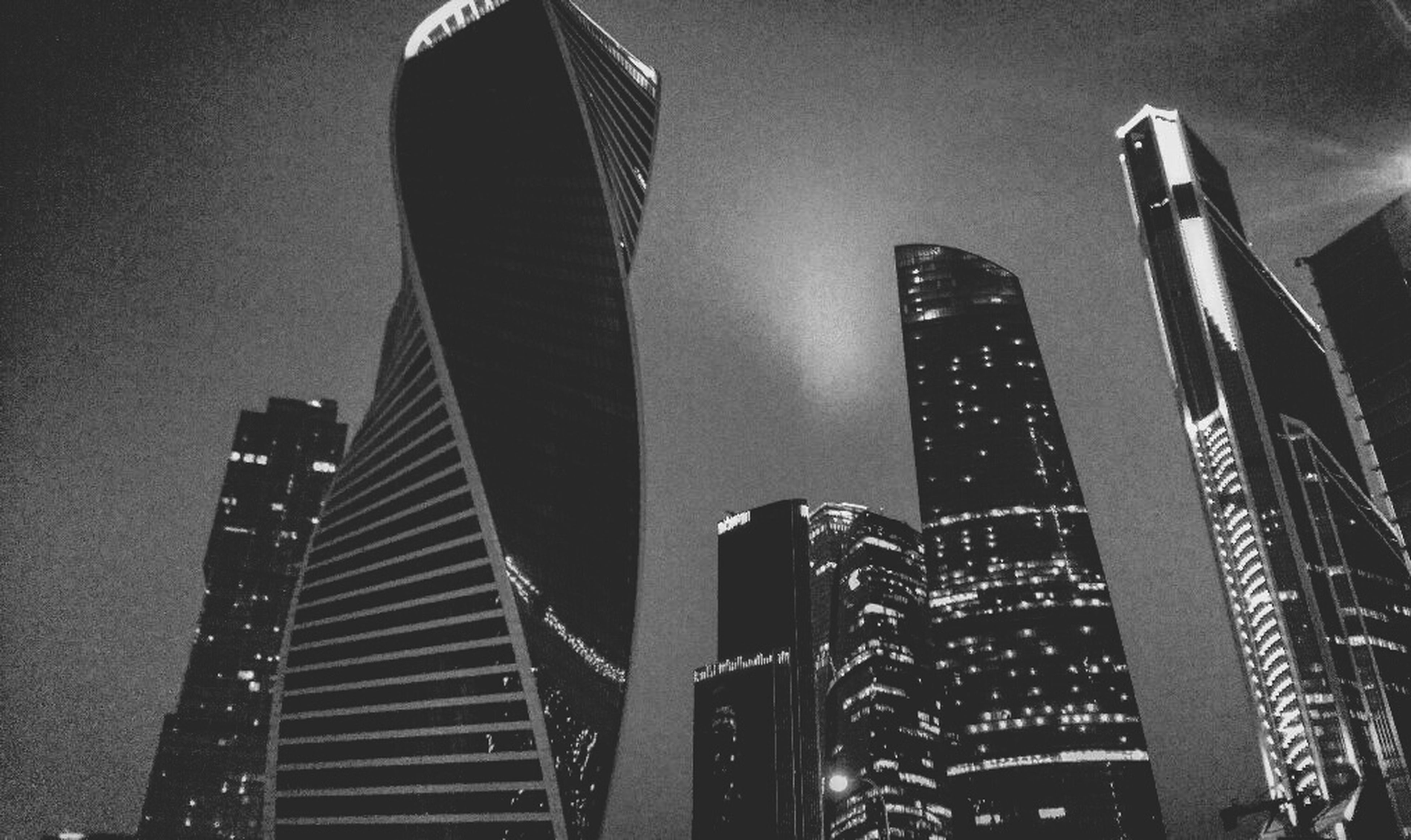 skyscraper, architecture, building exterior, city, built structure, low angle view, no people, modern, travel destinations, outdoors, growth, cityscape, sky, urban skyline, downtown district, night