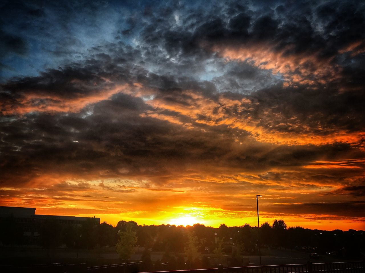 sunset, cloud - sky, dramatic sky, orange color, sky, silhouette, no people, built structure, scenics, architecture, beauty in nature, building exterior, nature, sun, tranquil scene, outdoors, tree, city