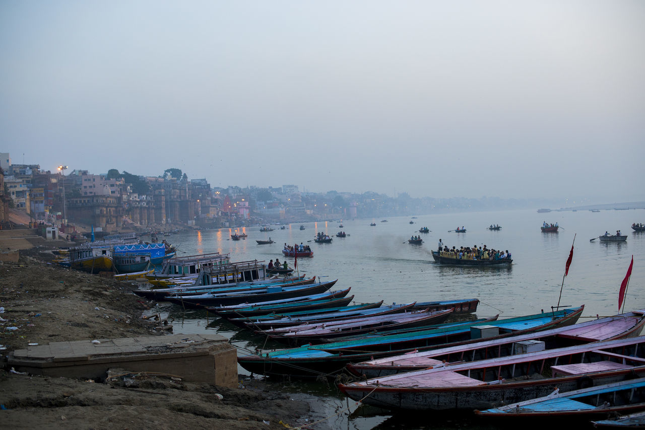 A view of the holy city Varanasi, India Day Harbor Holy City In A Row Moored Nautical Vessel No People Sunset Transportation Varanasi Water