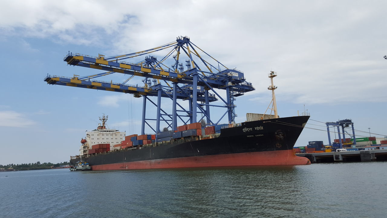 Business Cargo Container Commercial Dock Container Ship Crane - Construction Machinery Distribution Warehouse Freight Transportation Harbor Industrial Ship Industry Loading Mode Of Transport Moored Nautical Vessel Outdoors Passenger Craft Passenger Ship Sea Ship Shipping  Shipyard Trading Transportation Unloading Water