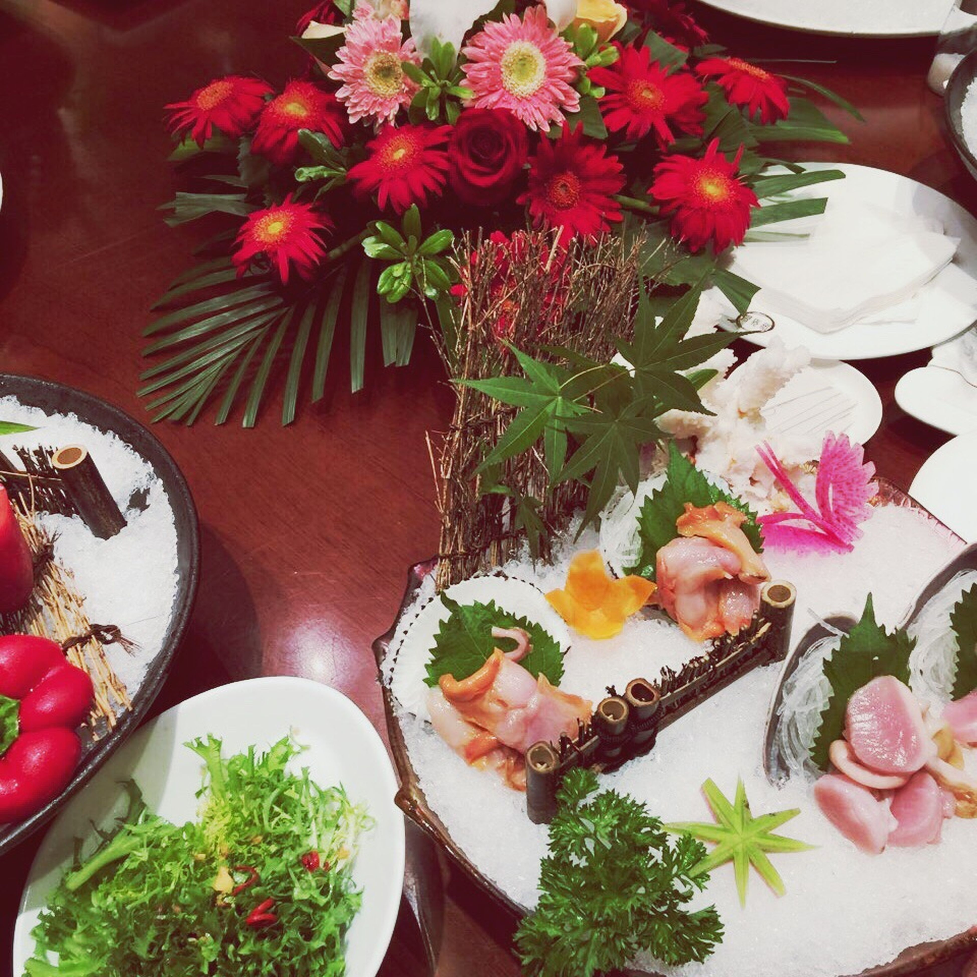 indoors, flower, freshness, bouquet, high angle view, variation, bunch of flowers, multi colored, petal, fragility, beauty in nature, ready-to-eat, no people, large group of objects, arrangement