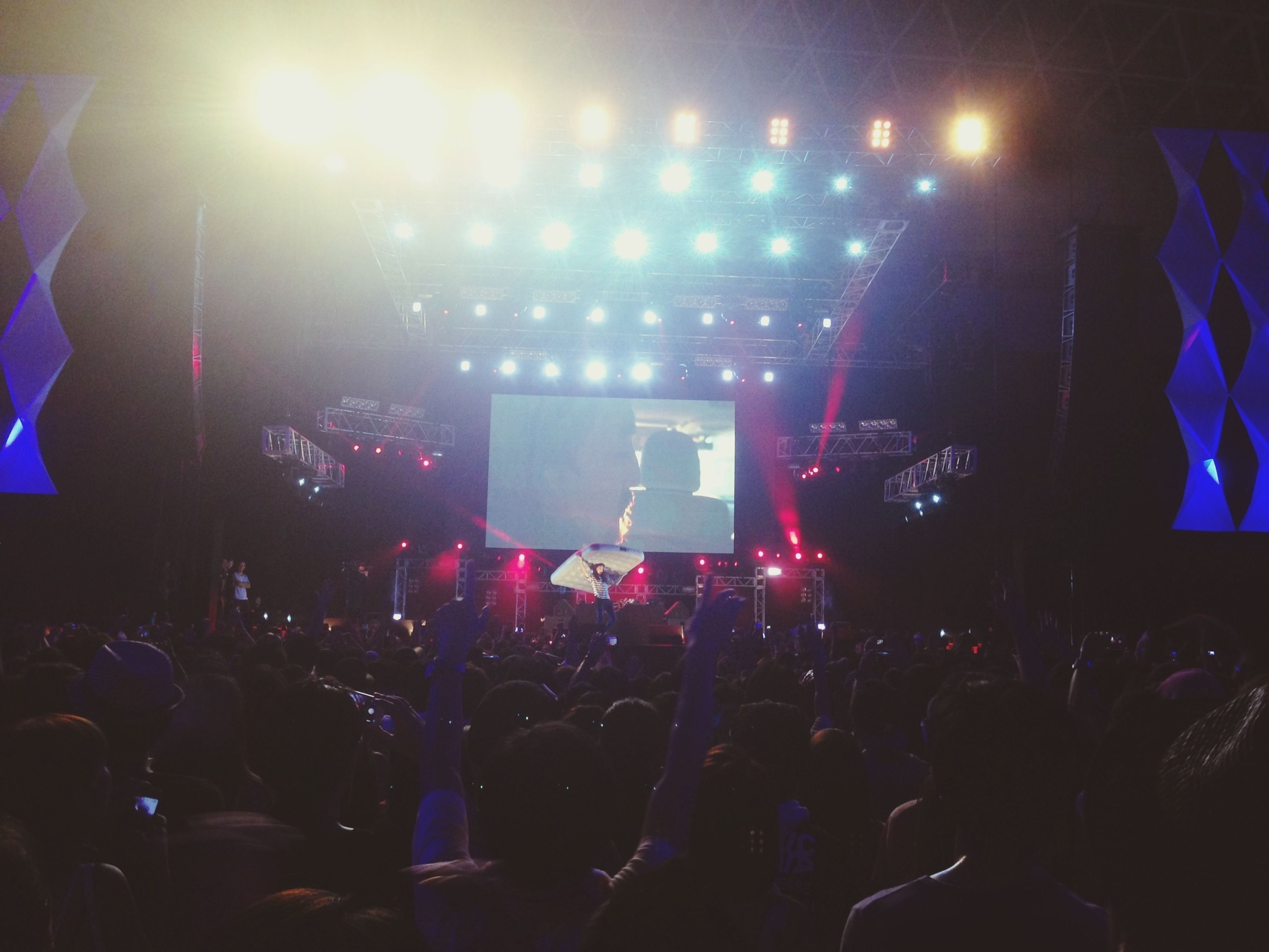 large group of people, illuminated, crowd, lifestyles, music, night, nightlife, men, person, arts culture and entertainment, indoors, concert, leisure activity, enjoyment, music festival, performance, stage - performance space, event
