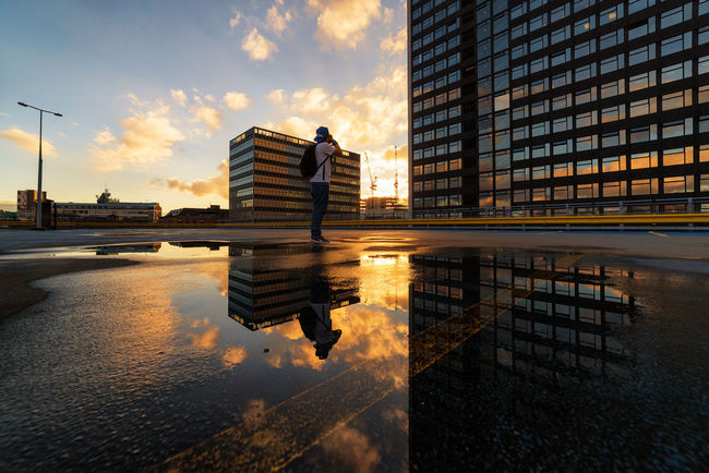 sunset behind buildings .re-uploaded this one due to tint issue with my android app. @casperyang Building Exterior Architecture Reflection Built Structure Water City Sky Puddle Cloud Sunset Cloud - Sky Office Building Sunshine Urban Geometry Dramatic SkyHome Is Where The Art Is Rooftop Daily Commute Today's Weather Report Manchester Today's Hot Look Cloud The Magic Mission Eyeemphoto EyeEm Masterclass