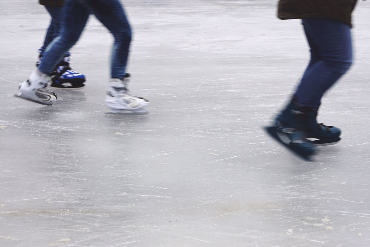 Ice Skating Ice Skating Rink Ice Winter Winter Sports Outdoor Motion Motion Blur Low Angle View Low Section Feet Unrecognizable People Leisure Activity