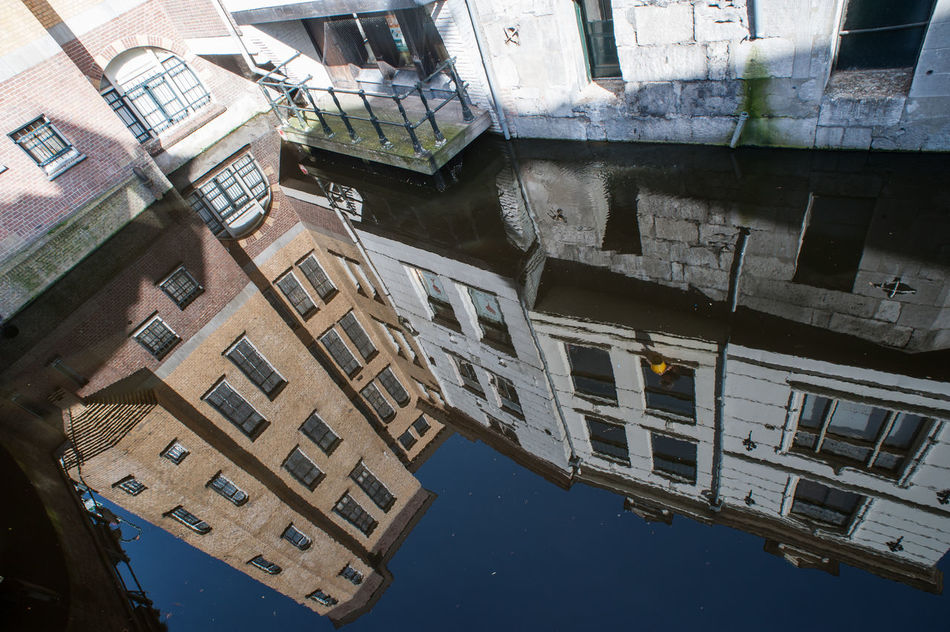 Gouda building reflections Architecture Building Exterior Built Structure Day Gouda Holland Netherlands No People Outdoors Reflection Travel Destinations Water Wideangle Window