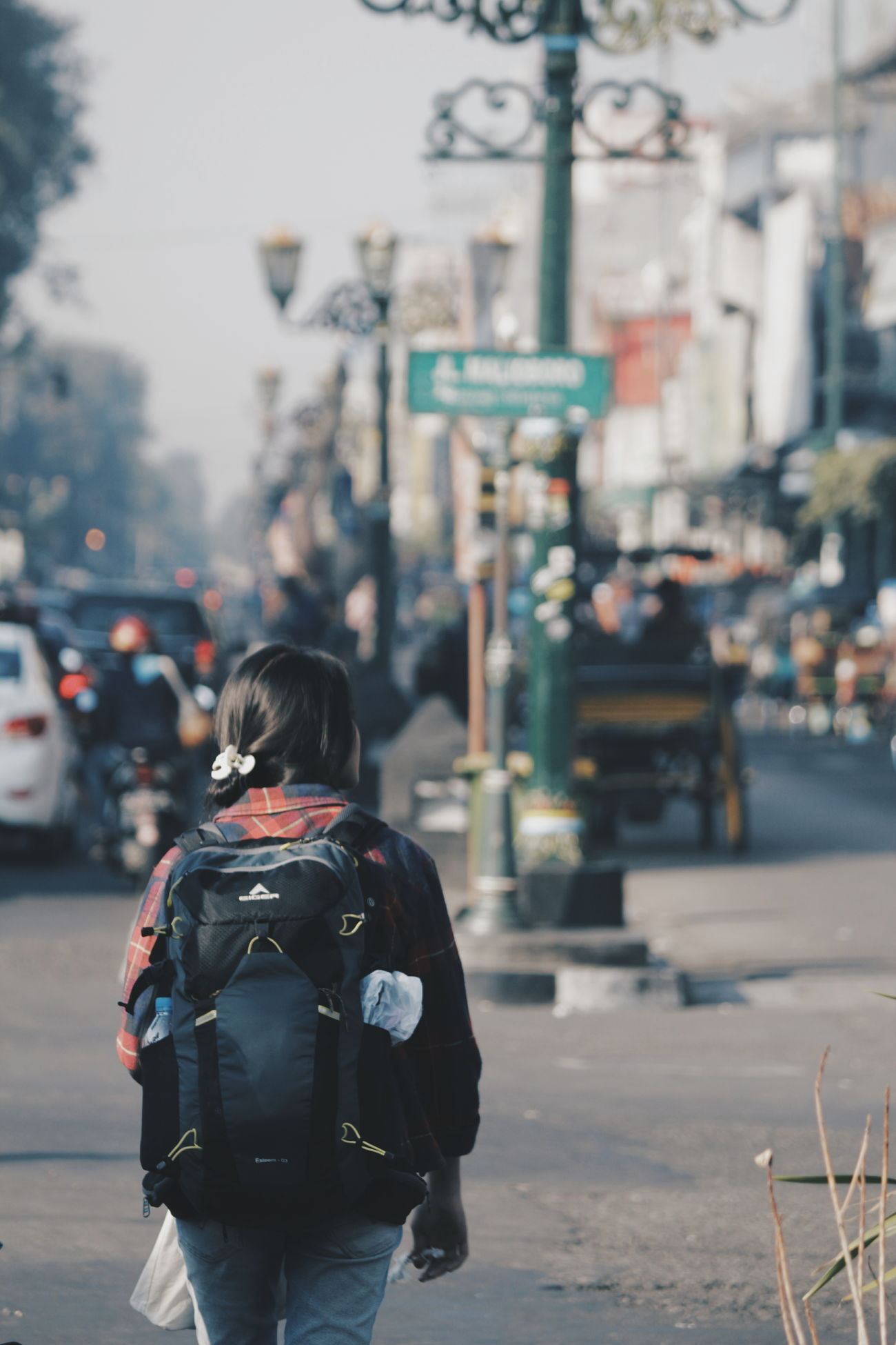 Traveling Home For The Holidays City Rear View Women Warm Clothing Men Outdoors City Life Winter Adult Adults Only People Social Issues One Person Real People Day Only Women Cityscape