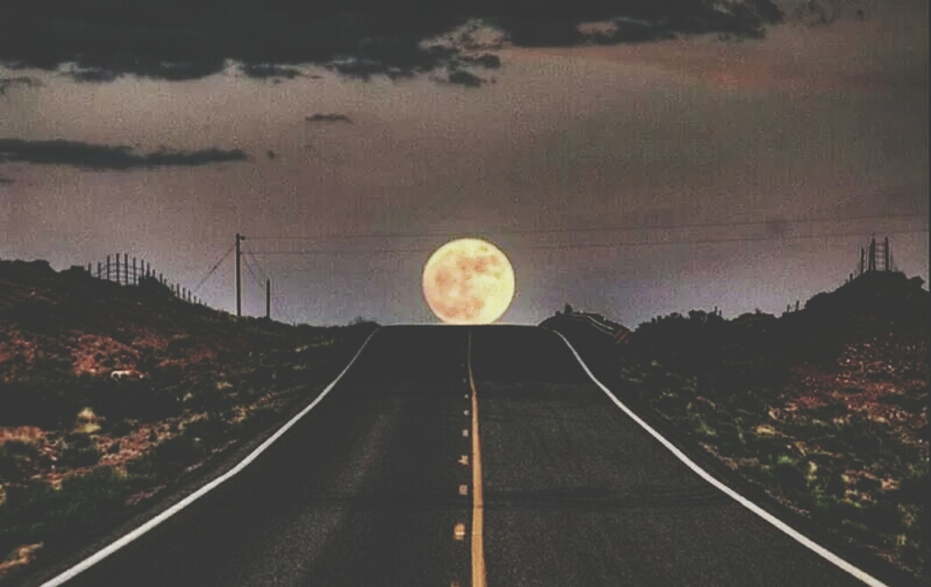 transportation, the way forward, sky, road, vanishing point, diminishing perspective, outdoors, landscape, railroad track, nature, no people, road marking, cloud - sky, dusk, street, night, high angle view, illuminated, circle, connection