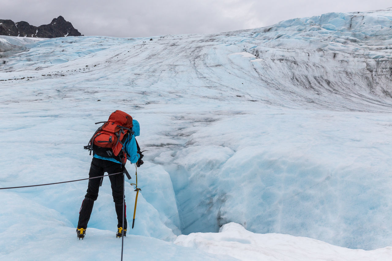 Adventure Arctic Backpack Blue Ice Climate Change Climbing Cramp Crevasse Glacier Global Warming Hiking Ice Ice Climbing Ice Cream Looking Into The Past Lyngen Lyngen Alps Northern Norway Norway One Person Rear View Rope Strupbreen Taking Pictures Woman