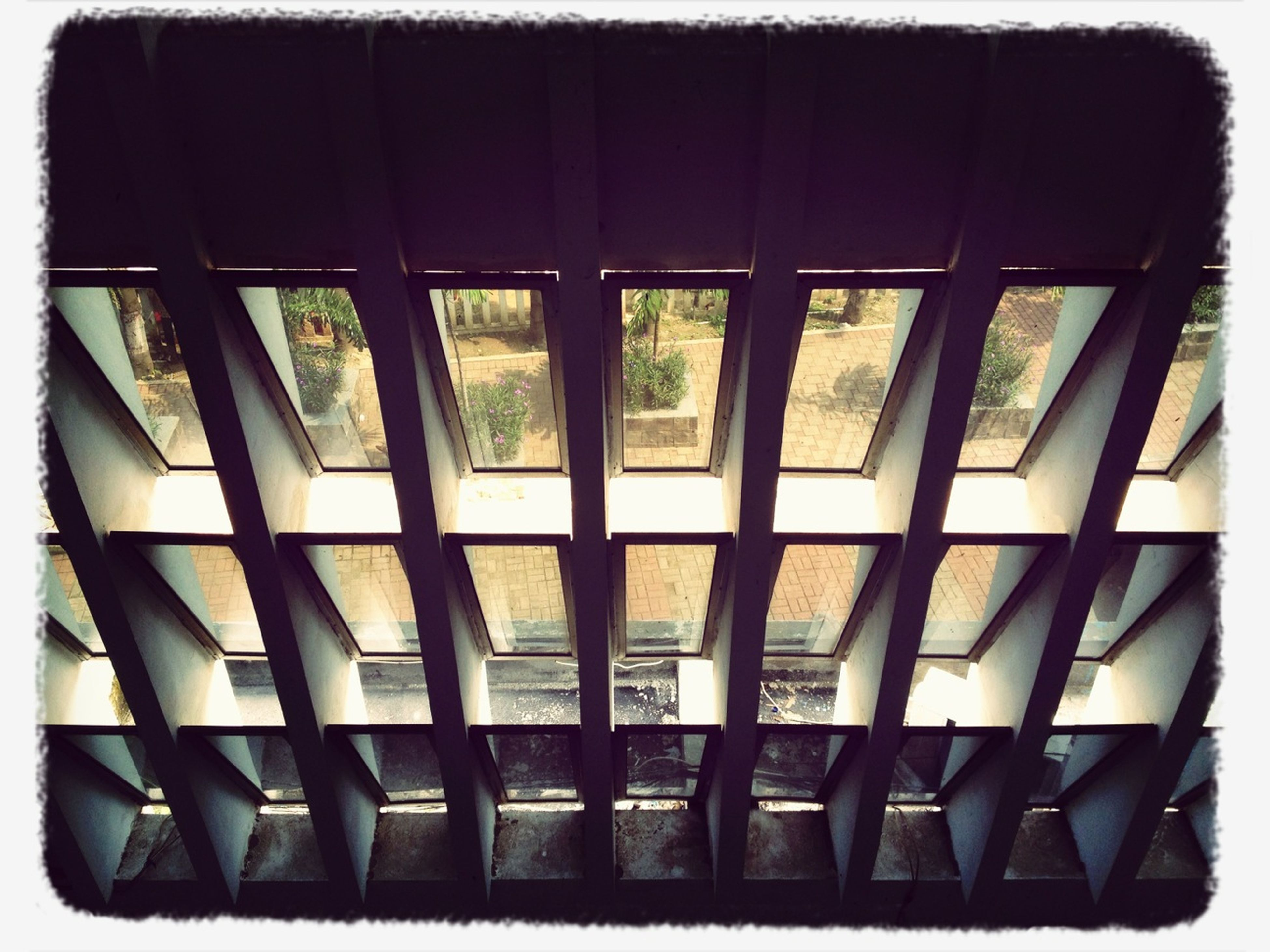 architecture, window, built structure, building exterior, transfer print, glass - material, low angle view, repetition, in a row, indoors, auto post production filter, modern, side by side, building, no people, day, full frame, pattern, backgrounds, geometric shape