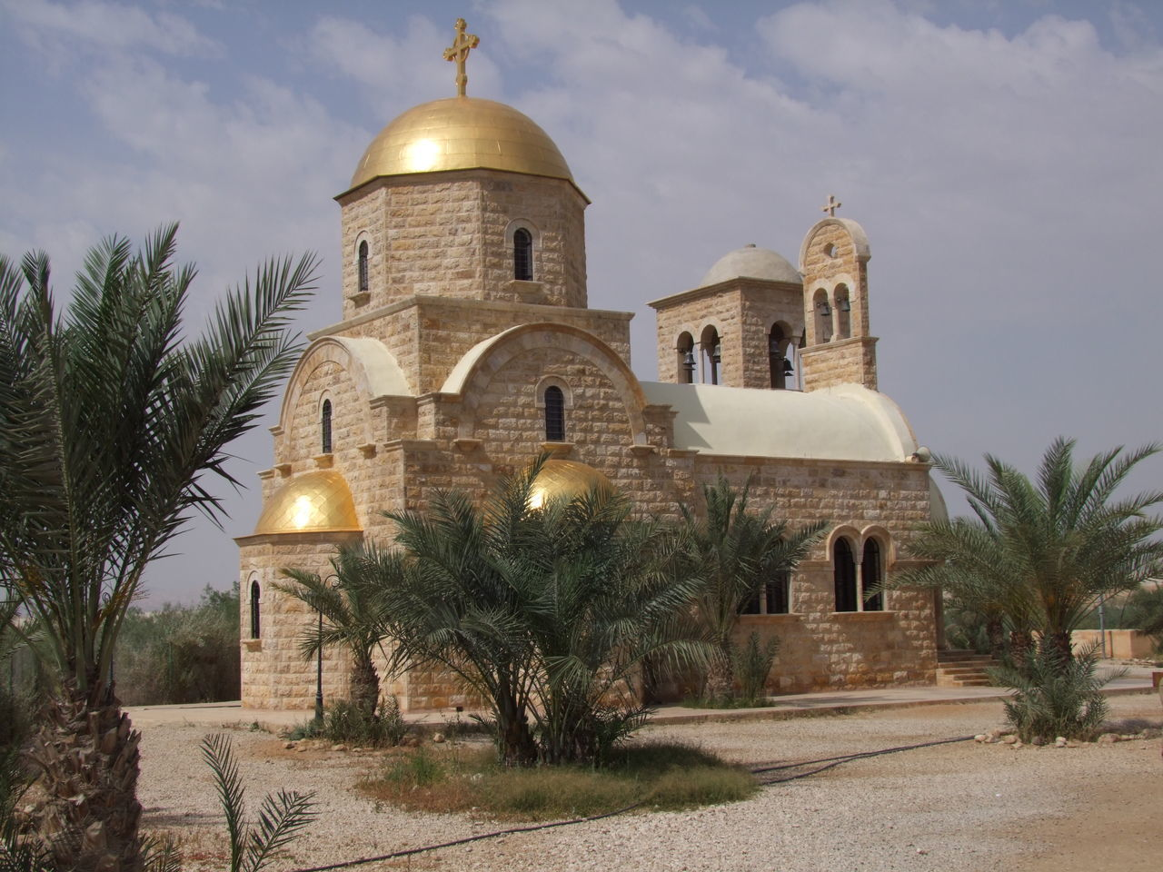 Greek Orthodox Church, Bethany Architecture Bethany Blue Sky White Clouds Building Exterior Built Structure Church Composition Cultures Dome Famous Place Full Frame Gold Cupola Greek Orthodox Church History Jordan No People Outdoor Photography Pilgrimage Place Of Worship Place Of Worship Religion Spirituality Sunlight And Shadows Tourist Attraction  Tranquility