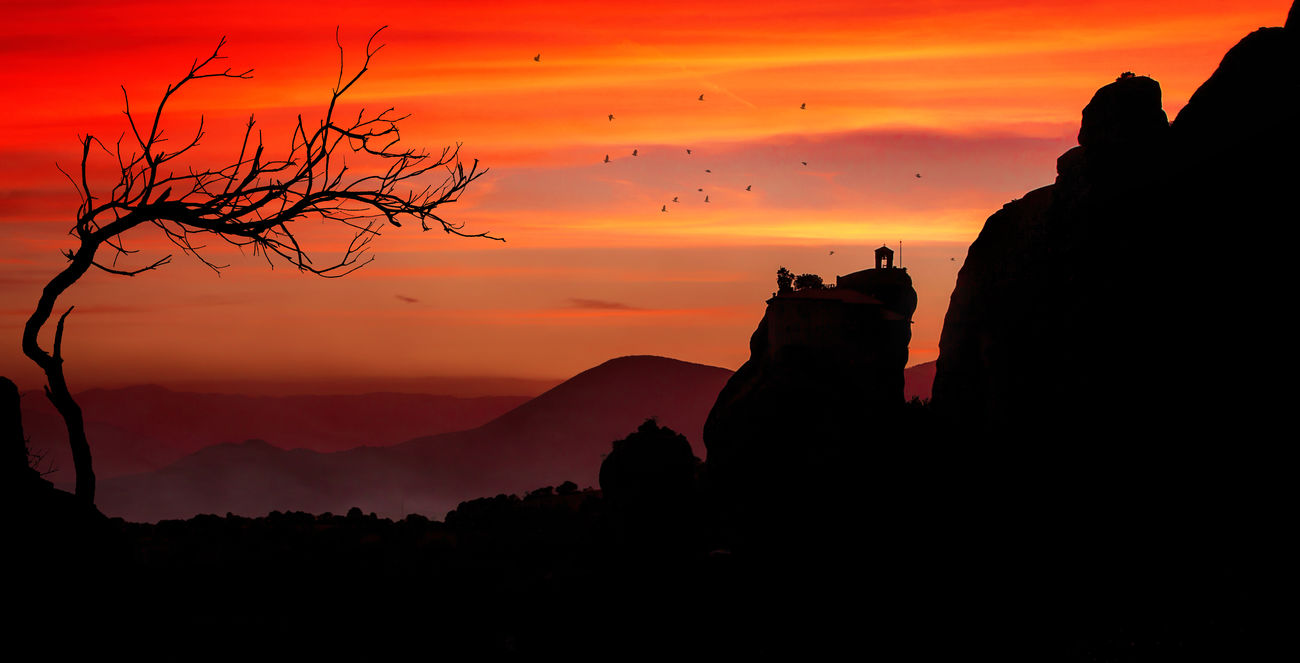 Silhouette of a monastery from Meteora Architecture Blackandwhite Castle Cliff Cloud - Sky Greece High Kalambaka Landscape Meteora Monastery Mountain Nature Orange Outdoors Red Rock - Object Scenics Silhouette Sky Sunset Tranquility Tree Tree Valley