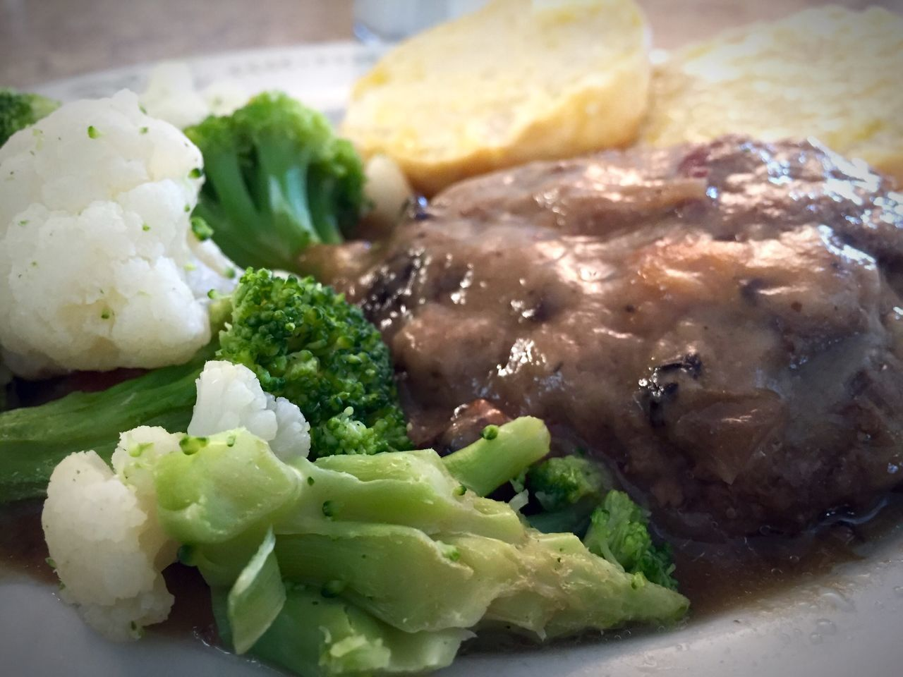 Hamburger steak with mushroom gravy and a side of broccoli & cauliflower. Biscuits Brocolli Cauliflower Close-up Focus On Foreground Food Freshness Hamburger Hamburger Steak Indulgence Lettuce Meal Meat Mushroom Gravy No People Ready-to-eat Selective Focus Served Serving Size Still Life Stuffed Temptation