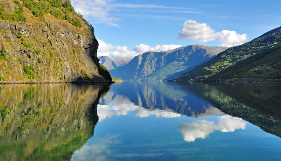 Beautiful scenery of fjords in Flam, Norway. Aurlandsfjord Backgrounds Beauty In Nature Blue Fjord Flåm Geirangerfjord Gudvangen Idyllic Lake Landscape Lysefjord Mountain Natural Parkland Nature No People Nordic Norway Outdoors Reflection Scenics Sky Travel Viking Water
