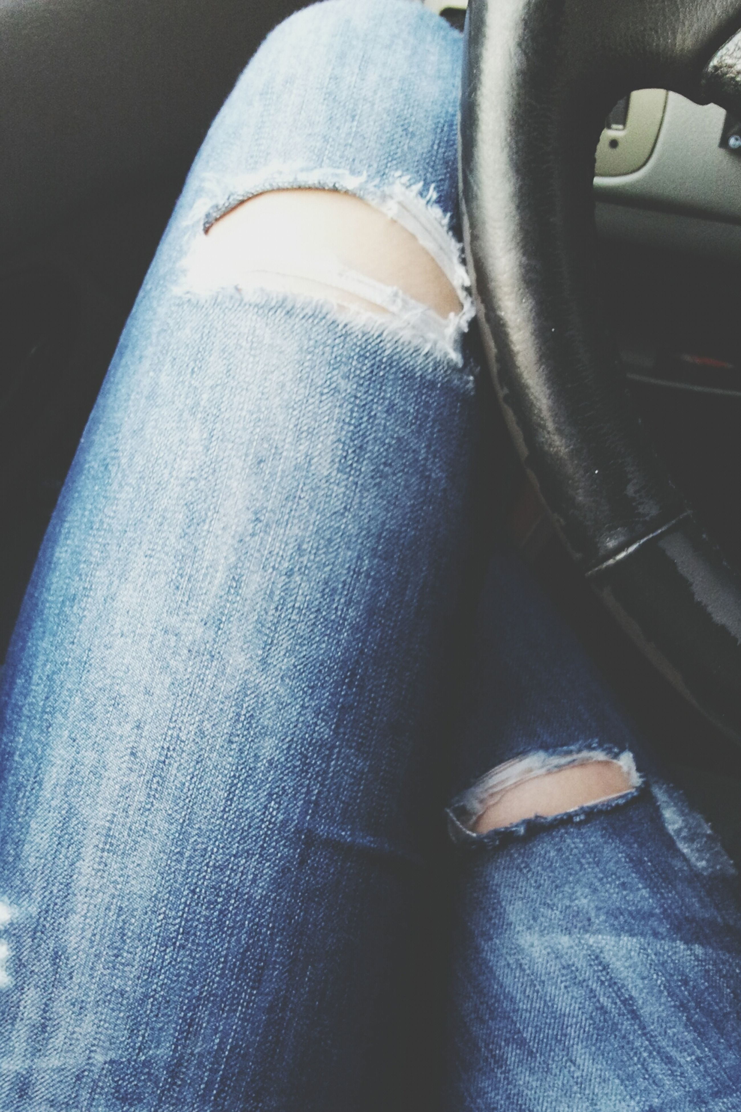 indoors, jeans, person, low section, close-up, shoe, transportation, mode of transport, land vehicle, footwear, high angle view, car, relaxation, part of, men, vehicle interior, sitting