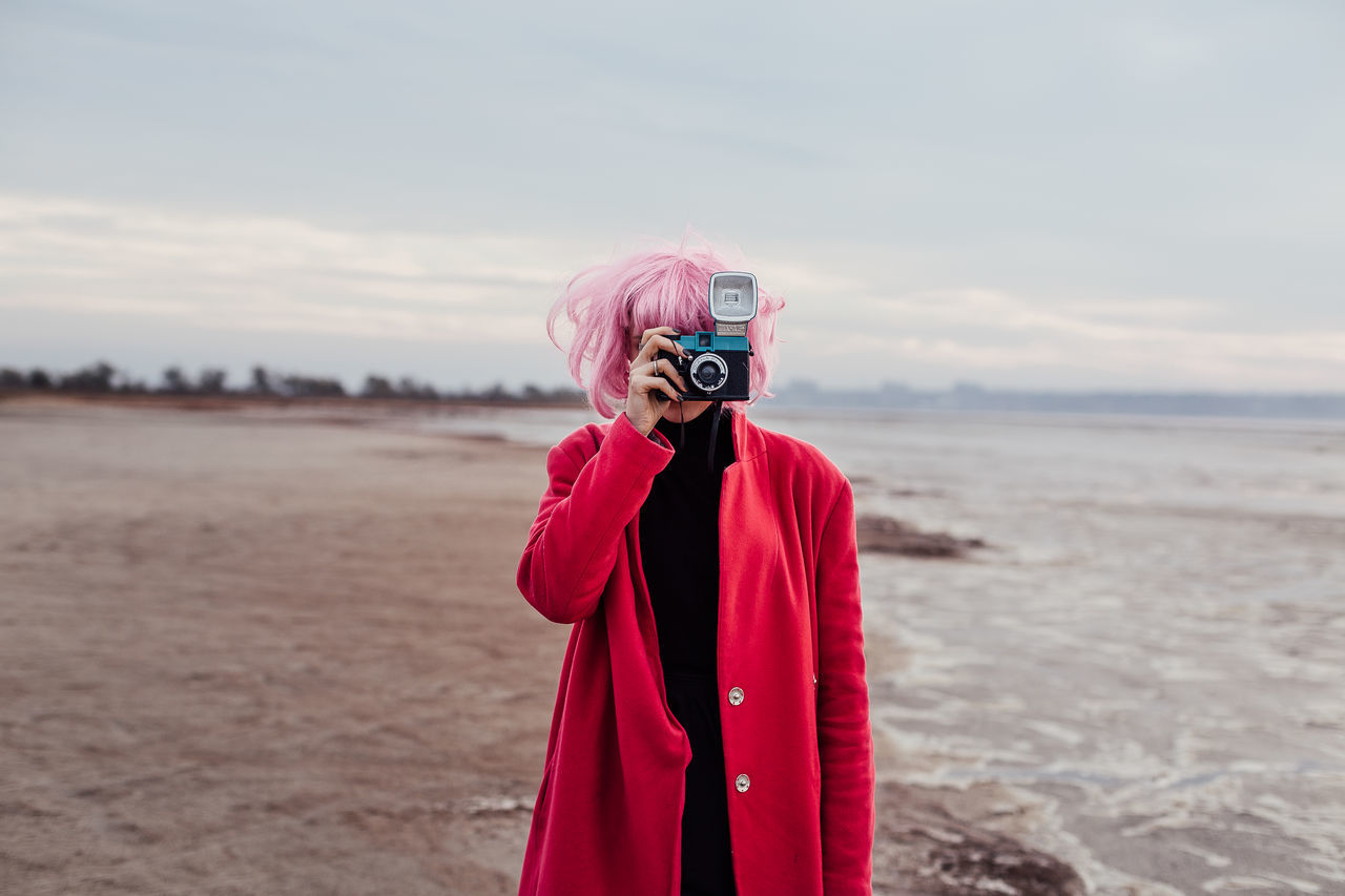 Photographic walk in the suburbs of Odessa Analogue analogue cameras Analogue Photography Bright coat colour of life Colour portrait diana Film film photography filmcamera girl lomo Lomography one person pink color seaside sky Standing Travel wig first eyeem photo EyeEmNewHere EyeEmNewHere
