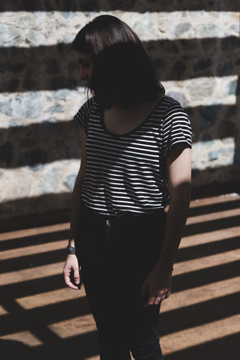 Dreamers. Adult Adults Only Day Human Body Part Human Hand One Person One Woman Only Only Women Outdoors People Shadow Standing Striped Young Adult